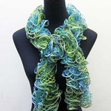image of a ruffle scarf in tones of sea green and blues, along the edge of the mesh runs a silver metallic poly woven in