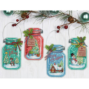 christmas ornaments cross stitch kit, christmas in a jar four different colored cross stitch canvases shaped like jars with different holiday characters, rudolph, christmas tree, gingerbread house and frosty the snowman