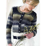 teen wearing a short cropped long sleeve cardigan with a subtle cable pattern running down the front. the sweater is knitted in a self striping yarn in colors of dark and light grey and tans