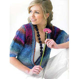 teen wearing a soft colored cardigan with a very low neckline and half length sleeves, knit in blended stripes of blue grey and fuschia