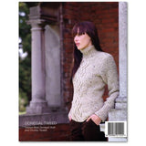 back cover of debbie bliss donegal tweed woman wearing a moss stitch turtleneck  with a cable pattern down the front