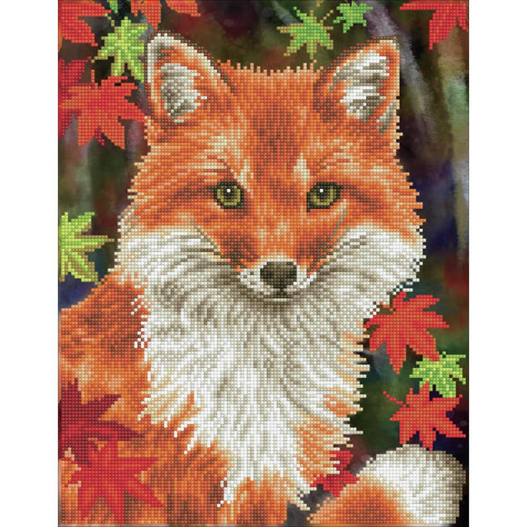 image of a regal fox in the woods showing the head and upper body turned and looking straight at us. the fox and aurrounding leaves are made up of tiny sparkly diamonds the shimmer in the light. the forest background is painted and dark, further accentuating the light catching properties of the gems
