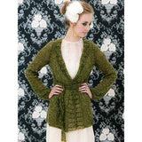 francesca long cardigan librarian sweater knitting pattern from louisa hardings simonetta pattern book #116 a young woman wears a long moss green knitted cardigan which is tied at the waist