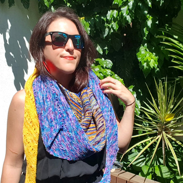 andrea mowry free your fade shawl knit in colors of bright yellow, blue and magenta purple