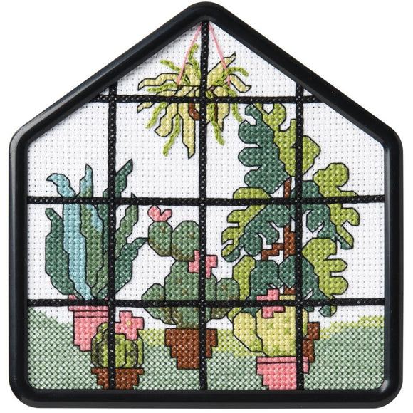 image of a beginners cross stitch design of plants in pots and hanging baskets behind a window pane in a greenhous.