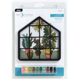 learn to cross stitch kit for kids front of packaging. the image shows the cross stitch design is of a bunch of plants in a greenhouse, with a custom shapes frame. Below the design is shows all the color coded threads are included already pre wound onto bobbins