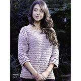 iamge of a woma wearing a ¾ length sleeve knitted sweater in pink rose color of mirasol yarns' hapi