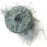 one ball of novelty eyelash yarn with long very thin lashes on colors of seafoam green and white