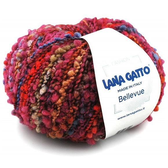 image of a ball of lana gatto's bellevue yarn in worsted weight boucle. the yarn features shifting colors of burgundy, blue, red and gold