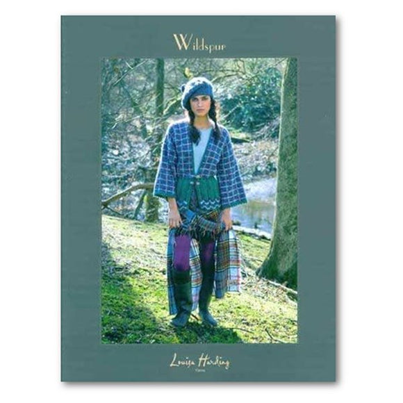 Cover of louisa Harding's wildspur knitting pattern book with a woman on the cover wearing a range of plaids and knits with a cabled beret and braided pigtails