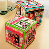 two craft cubes with family photographs and collage glued and sealed with mod podge