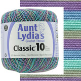 one ball of aunt lydias crochet thread size 10 in self striping colors of monets water lilies, lilac, ocean blue, sea green, moss green