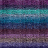 knitted swatch with horizontal stripes blending in tones of purples and blues noro tsubame yarn