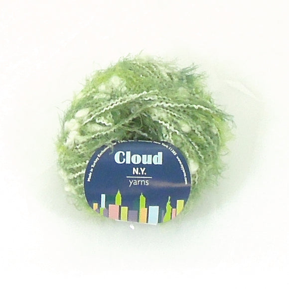image of one ball of new york yarns cloud yarn in teh green colorway lots of fuzzy eyelash green with strands and tufts of white fluffy clouds spun in