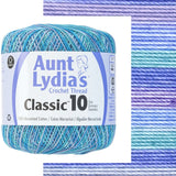 one ball of aunt lydias crochet thread size 10 in self striping colors of ocean multi shades of blue and teals