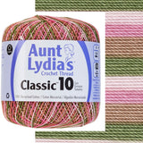one ball of aunt lydias crochet thread size 10 in self striping colors of pink camoflage pink, cream, tan, and green perfect for easter knit and crochet projects