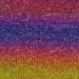 uluru rainbow bright colors in soft color changes of red, purple, blue, purple, red, orange, yellow with white flecks knitted throughout