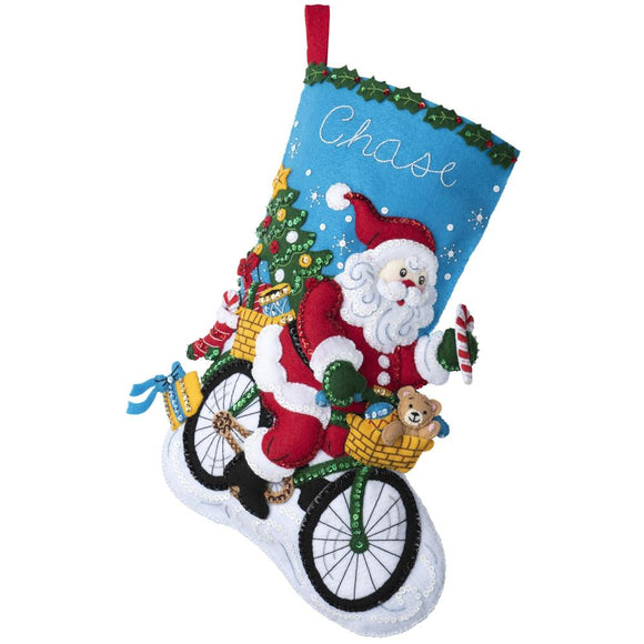 felt christmas stocking kit with a design of santa claus riding a bicycle to deliver presents