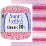 one ball of aunt lydias crochet thread size 10 in self striping colors of light and dark pinks