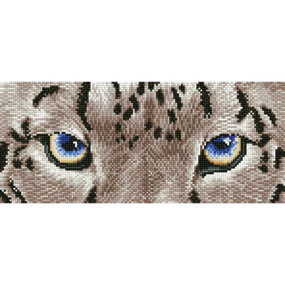 close up image of snow leopard eyes ready fro the hunt. the image is made up of thousands of tiny sparkling diamonds