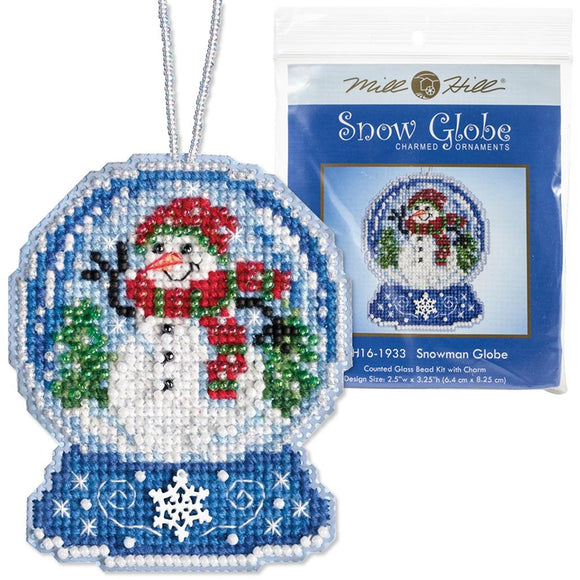 christmas holiday cross stitch kit with beads, in a design fo a snowglobe with a happy waving snowman in it wearing a green and red scarf, the cross stitch includes shimmering beads and a white snowflake charm