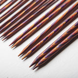 detail of of the tips of knit pick radiant interchangeable needles showing their perfectly pointed tips and rainbow color effect
