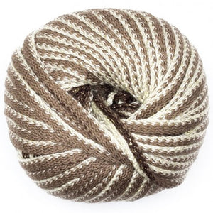 ball of feza's eva yarn showing that its a knitted chainette yarn in two tones, a tan muted brown and a white light cream. you can see hidden within the ball is a dark brown with metallic thread color change in the strand