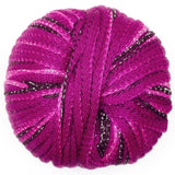 ball of feza's eva bulky chainette yarn in fuschia birght pink anf black with metallic pink edging