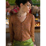 Sylph knitting pattern from Louisa Hardings Hummingbirds Pattern book. woman wearing a lightweight tan light brown button up cardigan with metallic fibers