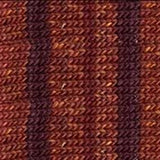 knitted swatch in stripes of dark ruddy brown alternating with stripes of a reddish rusty borwn with a little bit of variegation so its not flat color