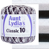 one ball of aunt lydias crochet thread size 10 in self striping colors of zebra, shades of black, grey and white