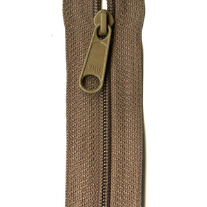 image of ykk ziplon zipper with small plastic zip and large o pull ring