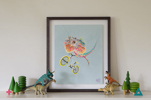 A Lizard artwork by Good Art Australia. Painting framed and sitting on a shelf with kids toys.