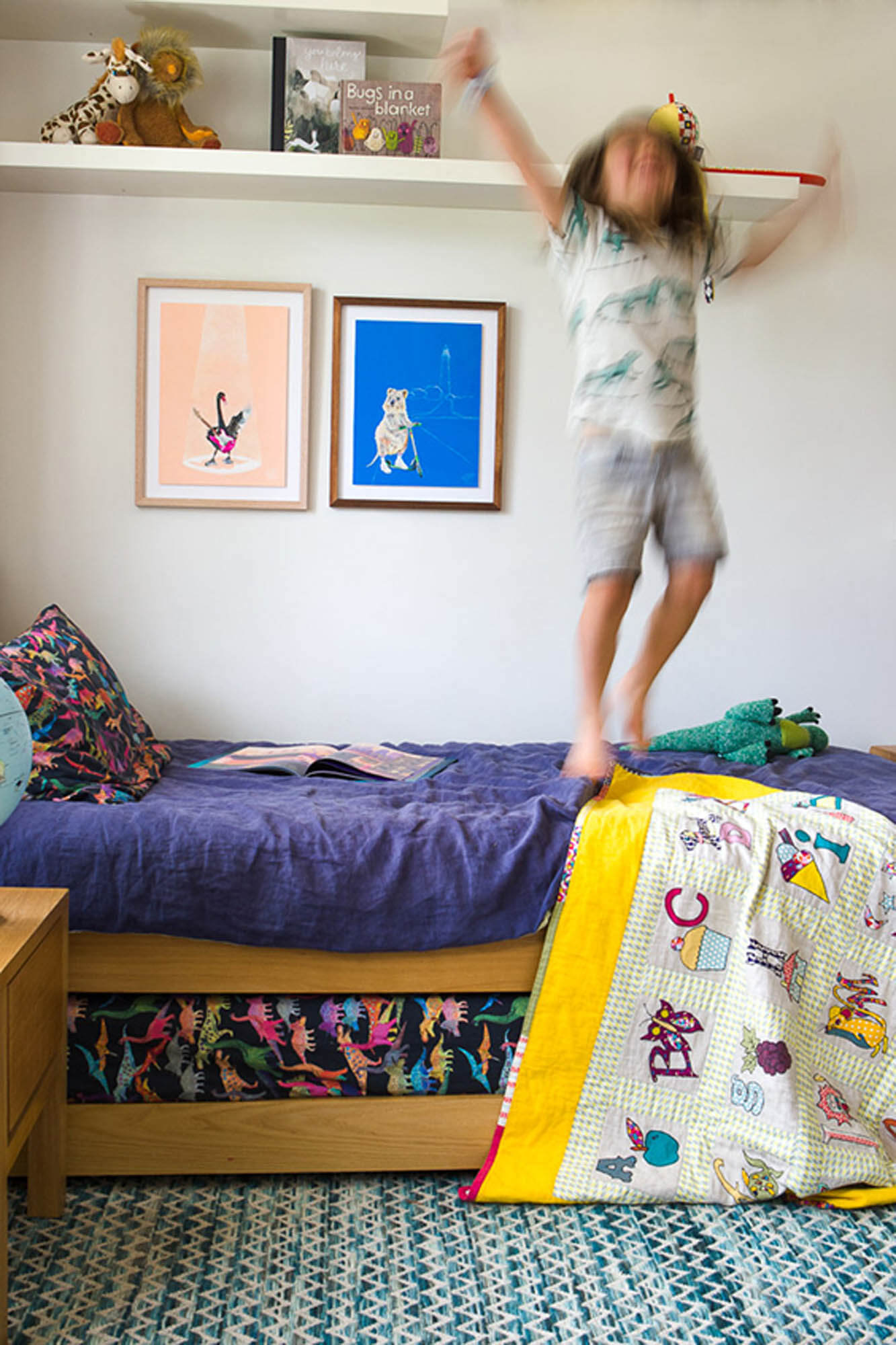 Boy jumping on bed, featuring Rottnest Island Quokka print, Bakery Run.
