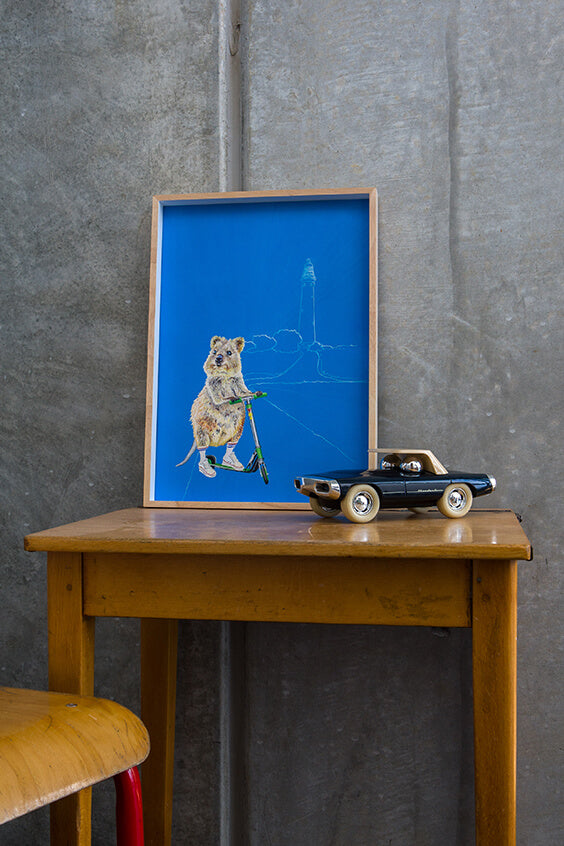 Artwork on children's vintage desk with vintage style car, featuring Rottnest Island Quokka print, Bakery Run.