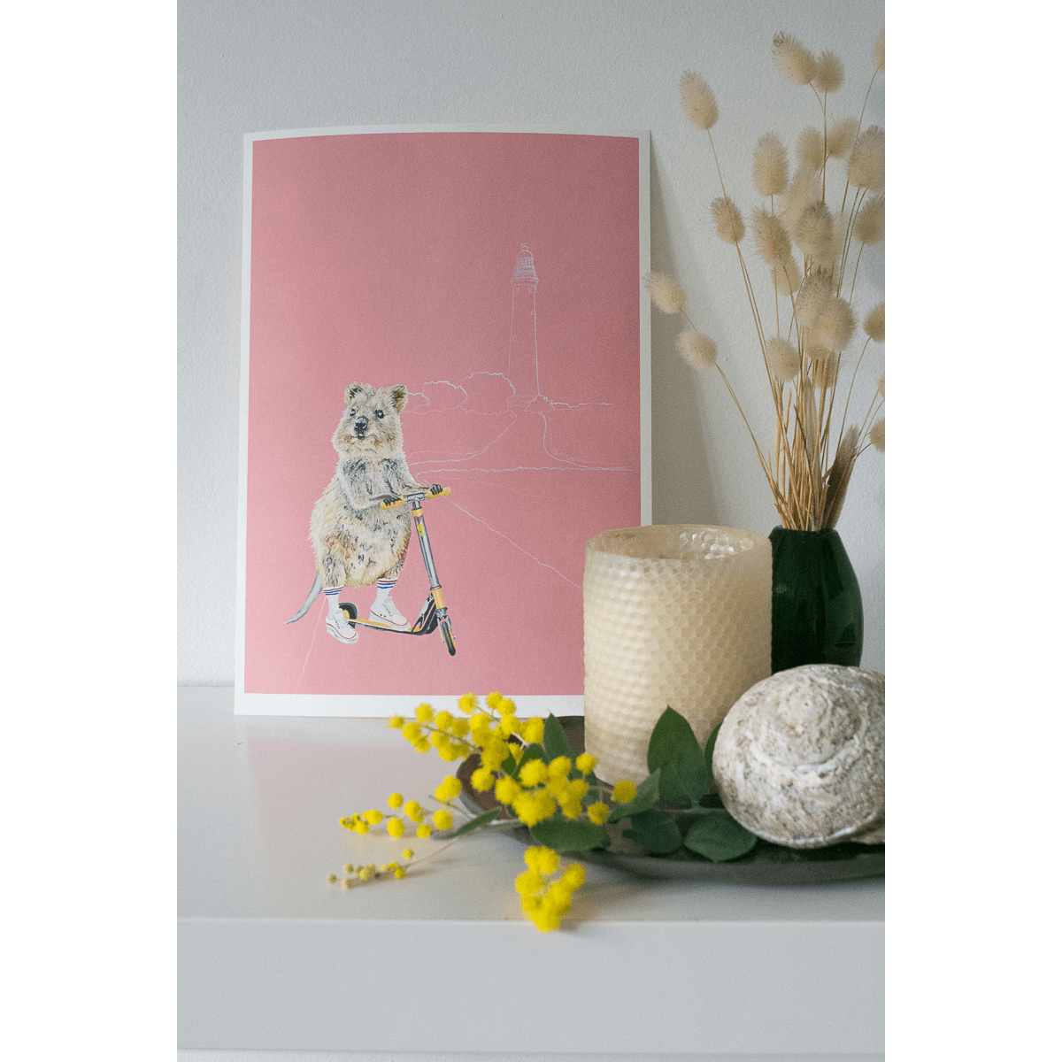 An Art print of a quokka riding a scooter on Rottnest Island, Western Australia. Styled in an Australiana themed kids bedroom. Created by Good Art.