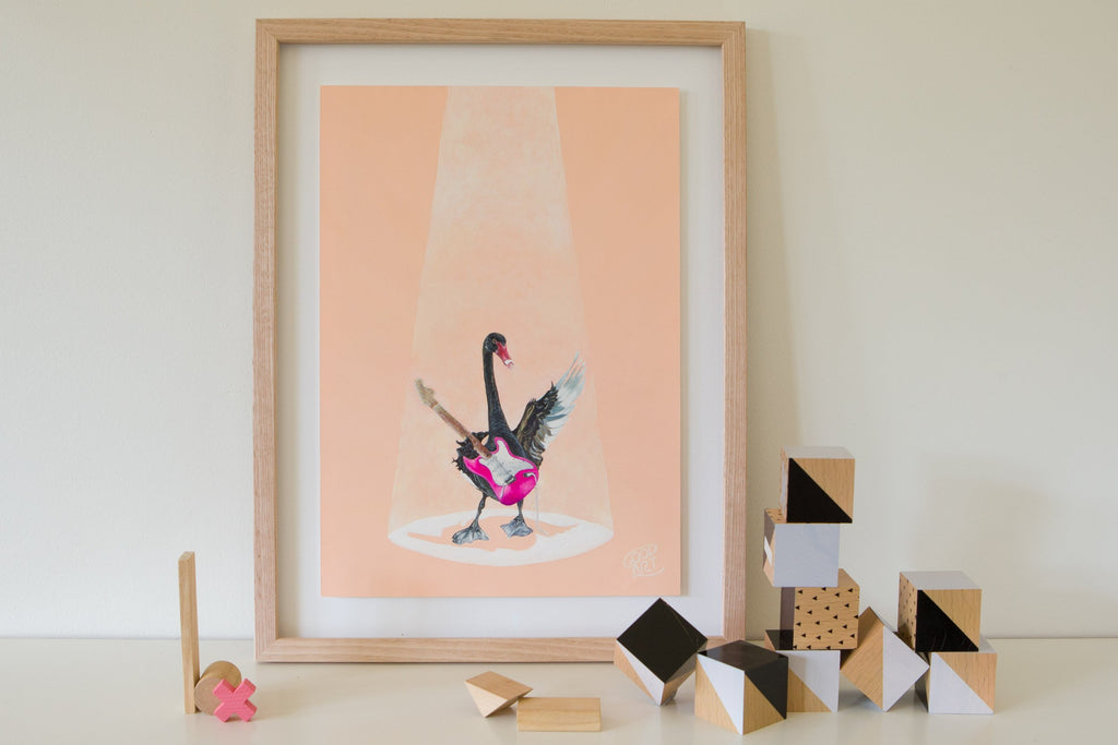 A painting of a Western Australian black swan playing a pink electric guitar on blush coloured background. A colourful animal print for kids bedroom painted by Jaelle Pedroli.