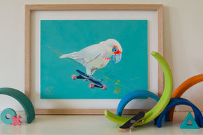 A colourful artwork of a Corella from the Cockatoo family of native Australian birds riding a skateboard. Bird print for kids painted by Jaelle Pedroli. Artwork sits on shelf with wooden toys.