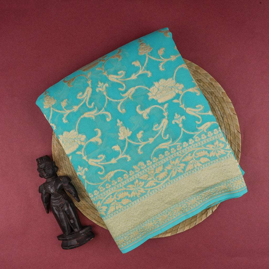 Cyan Blue Banarasi Georgette Saree With Floral Jaal Design
