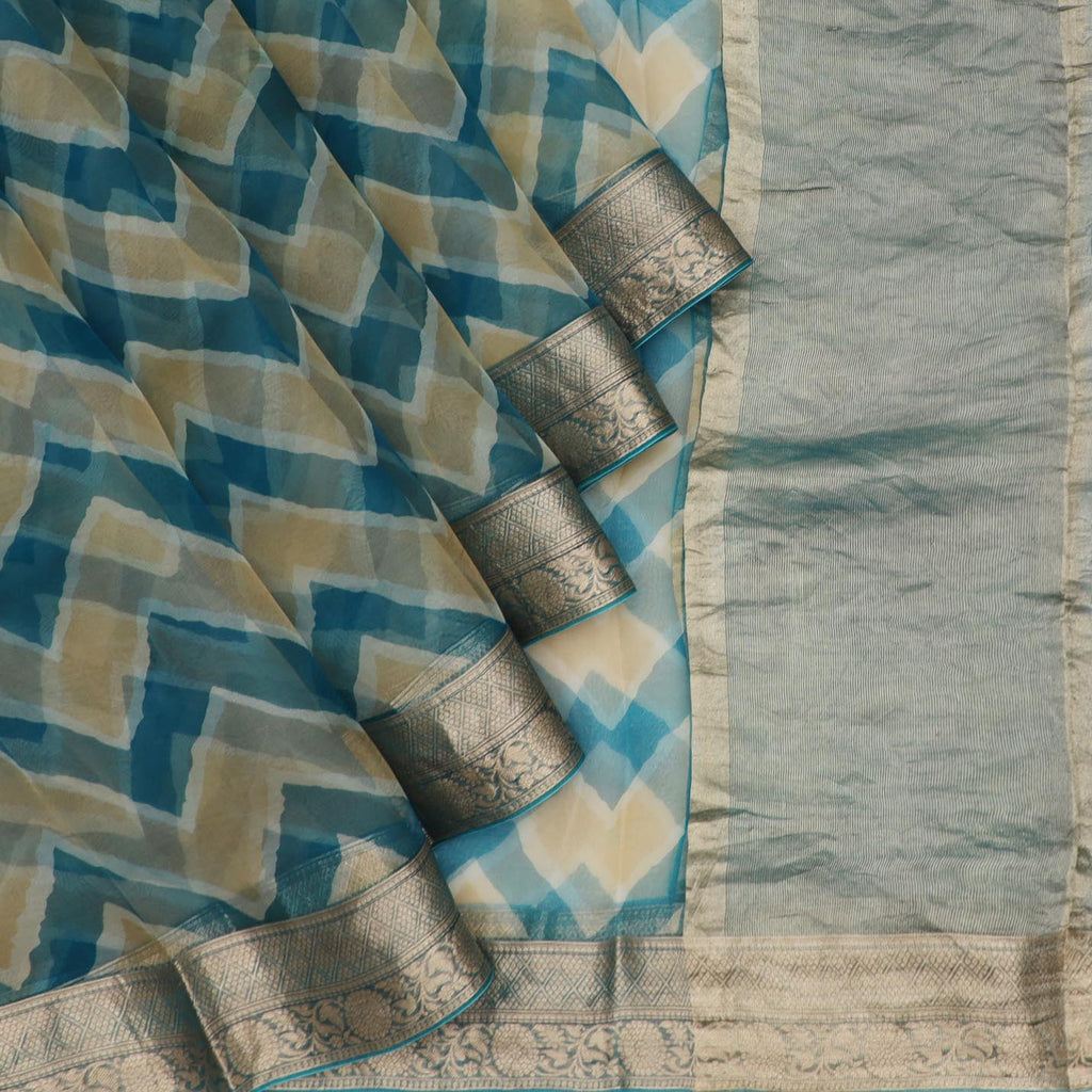 Peacock Blue And Beige Leheriya Printed Organza Saree