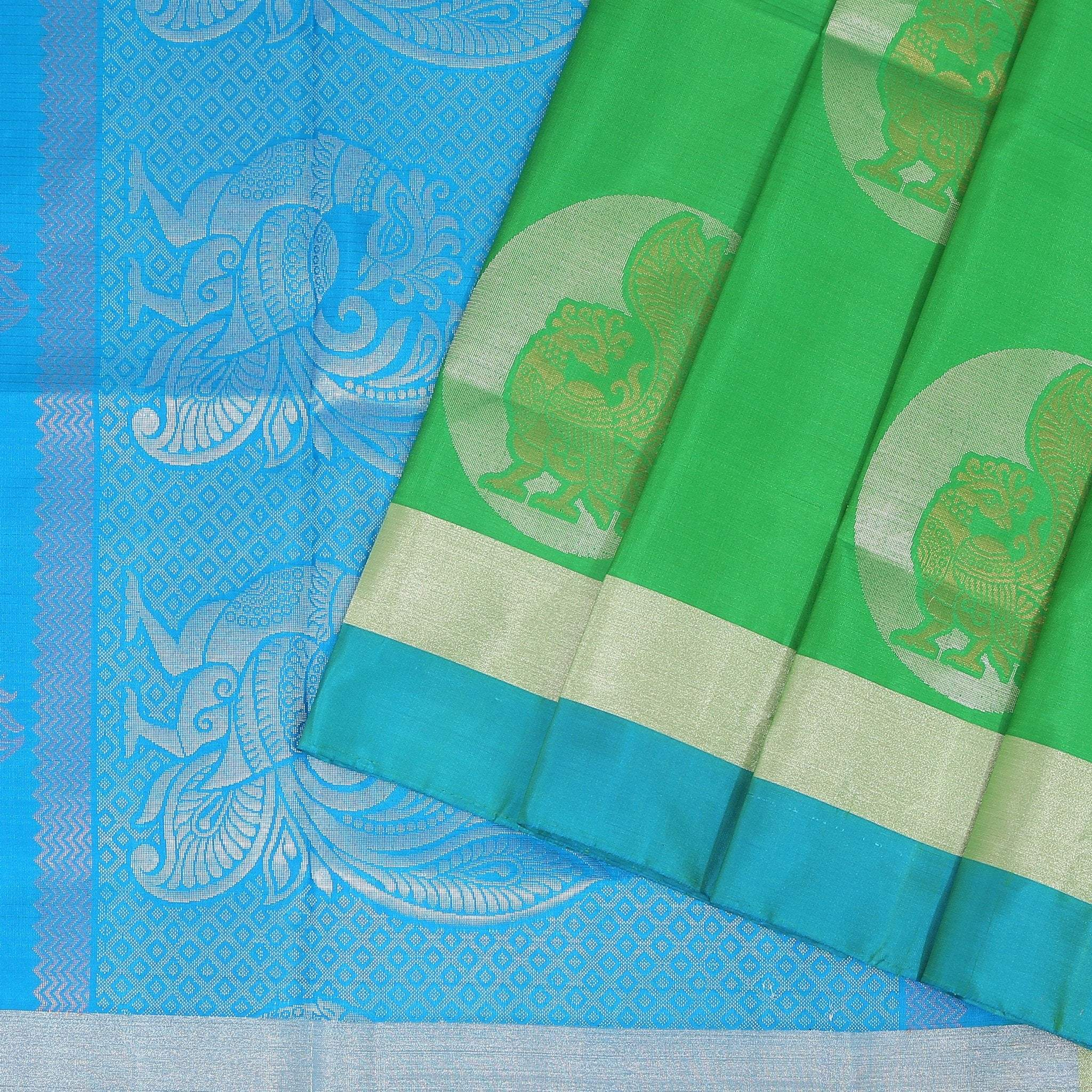Parakeet-Green-Soft-Silk-Saree-with-contrast-Electric-Blue-border-and-pallu.