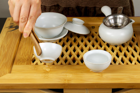 Handle hot tea cups with tweezers