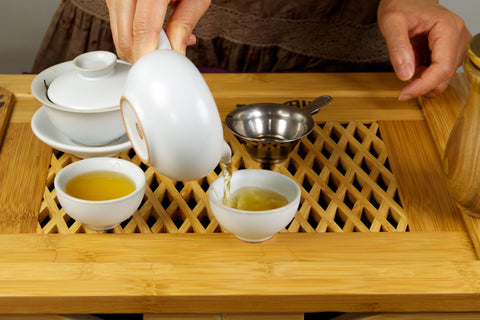 Pour tea into tea cups