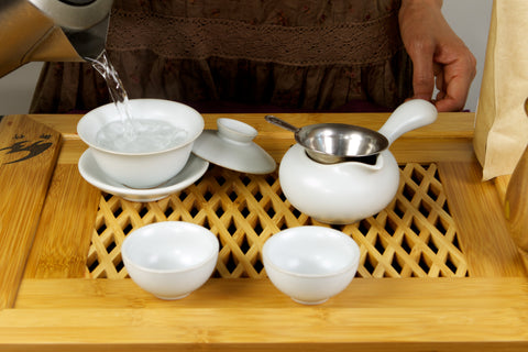 Wash gaiwan with hot water