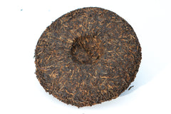 2010 aged puer tea cake on white surface