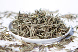 Plate of loose leaf baihaoyinzhen white tea silver needle from fujian china