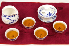 See through white tea set with blue flowers