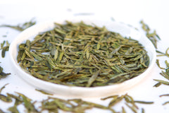 Tray of loose leaf green tea dragon well long jing