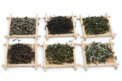 Yezi samples white black oolong green teas on bamboo trays