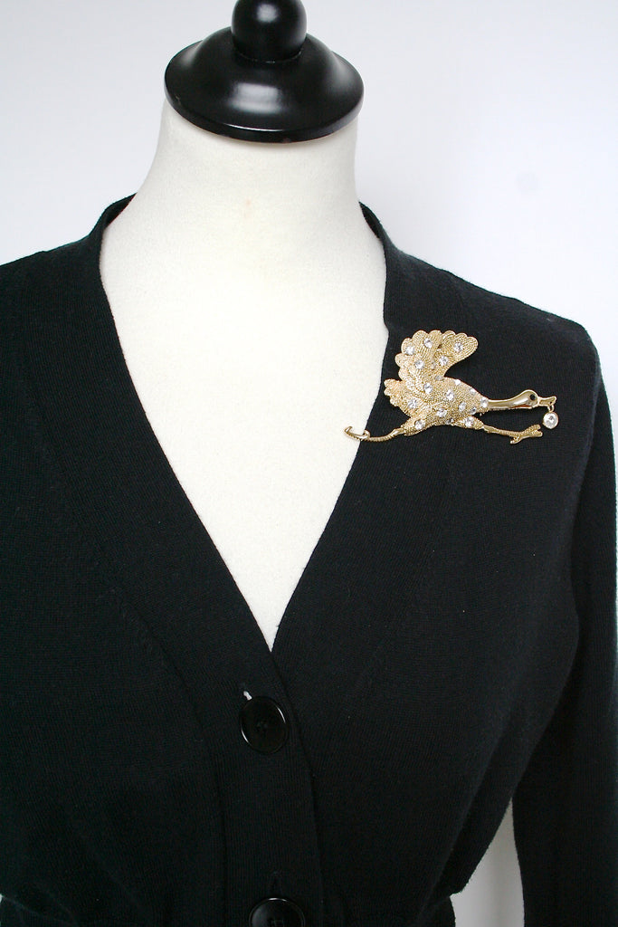 Flying goose brooch in gold and diamante